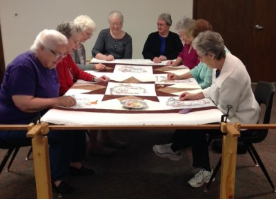 East Union Mennonite Women hand-quilting a quilt which will be sold at the Pleasantview Home Benefit November 4 or 5, 2016